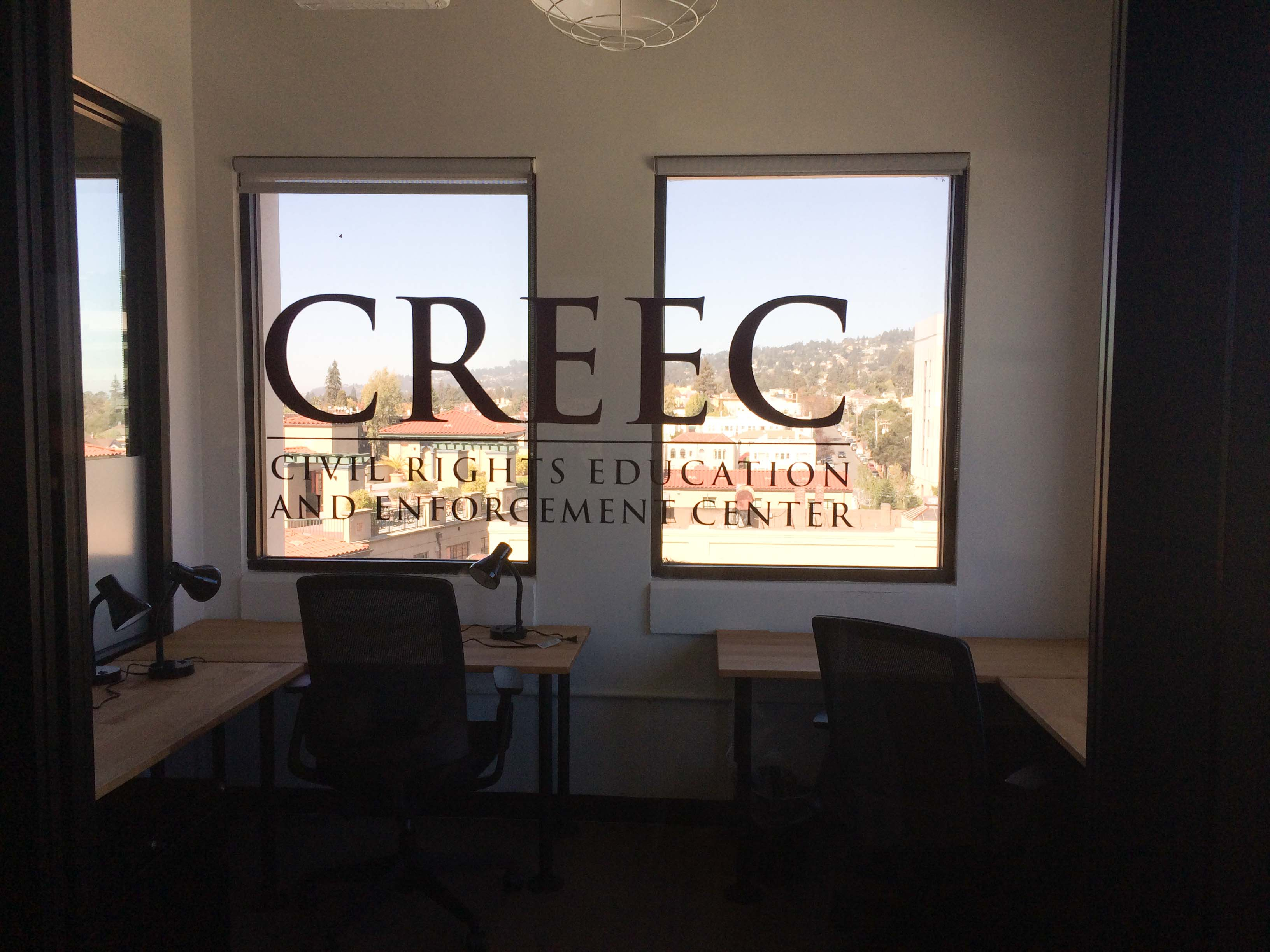 Image:  CREEC logo painted on the front window of new office space.