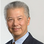 Image: photo/headshot of Asian man with salt and pepper hair wearing a suit jacket and tie