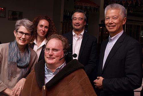 Group standing: two Caucasian women, two Asian men, and one Caucasian man.