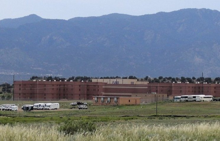 View of Colorado State Penitentiary with mountains in background
