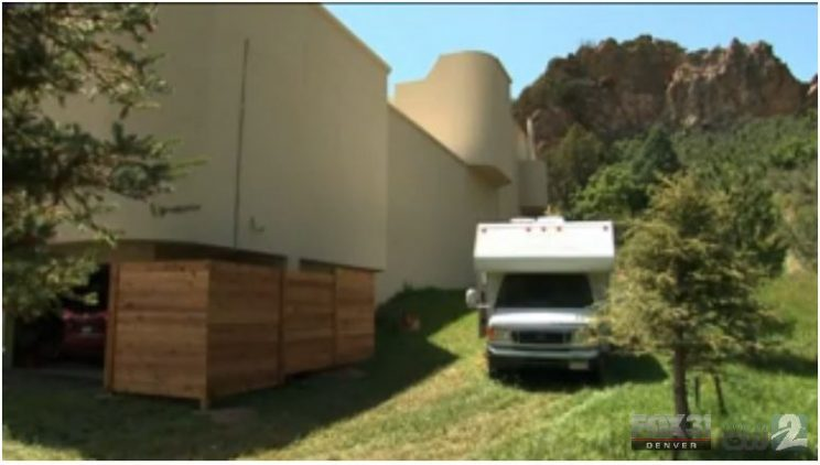 Image: An RV parked next to the side of a large, modern house. The house dwarfs the size of the RV. The photo contains the logo of Fox 31 Denver.
