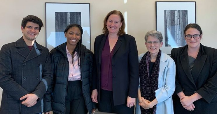 One man and four women standing together. Pictured are CREECs two January externs, attorney Gail Johnson, Co-executive Director, Amy Robertson, and paraleagal, Marieme Diop